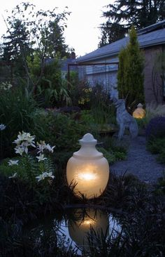 Old lamp post lights used in the garden...awesome!
