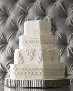 Art-Deco Dessert: You don't need to know your Art Deco from your Art Nouveau to admire this cake's geometric Gatsby style. Covered in buttercream, piped dots of frosting, and cut-fondant plaques coated with sanding sugar, it's just plain pretty, no matter how you slice it.