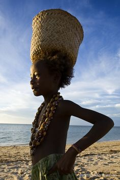 Africa |  Vezo girl, Sylvie, sells beads on the beach.  Anakao, Madagascar | © Stephan Brauchli