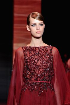 A model walks the runway during the Elie Saab show as part of Paris Fashion Week Haute-Couture Fall/Winter 2013-2014 at Palais Brongniart on July 3, 2013 in Paris, France.