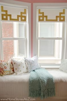 How to dress up simple roller shades using gold duct tape in a Greek Key design. Inexpensive window treatment idea.
