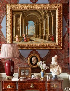 In the master bedroom, a 17th-century Italian capriccio painting is displayed above a neoclassical bas-relief cameo and a 17th-century marble bust.