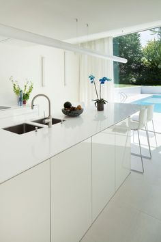 dmvA have designed a contemporary renovation of an existing house, located near Brussels, Belgium.