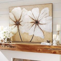 Metallics have made their way into all areas of the home, and now you can happily welcome them to your walls, with our hand-painted art on canvas that blooms with style. Silver, pewter and gold tones combine to form iconic blooms that seem to radiate light throughout your living, dining or bedroom areas.