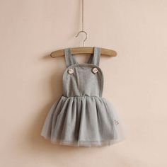 Most comfy flower girl dress ever. Made of soft grey jersey and just adorable. Suspender style little girls dress via Etsy.