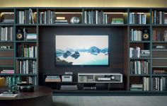 57 a. TV Unit -  Poliform Wall System. Flexible system which allows for a wide range of design solutions for a entertainment centre - library.