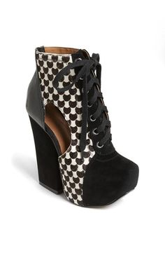 The shape and cutout detail add interest to this black & white boot. Just add colorful tights!