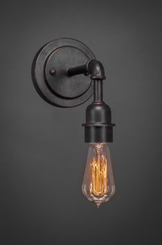 One Light Wall Sconce in Dark Granite by Toltec Lighting from the Vintage collection. Farmhouse Wall Sconces, Vintage Wall Sconces, Farmhouse Light Fixtures, Rustic Wall Sconces, Farmhouse Lighting, Wall Light Fixtures, Rustic Wall Lighting, Modern Bathroom Lighting, Industrial Wall Lights