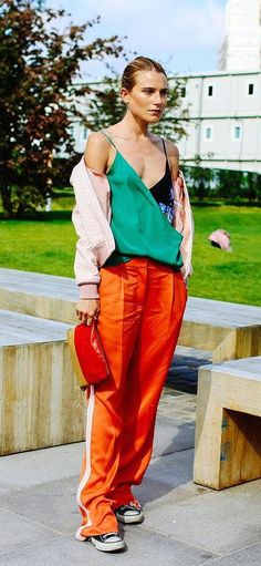 Dree Hemingway in orange trousers, converse and a v-neck top
