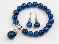 Classic design round blue agate beaded bracelet with matched earrings.  $14.99     #jewelry #bracelet #turquoise #earrings #amethyst #turquoise earrings #turquoise bracelet #black agate