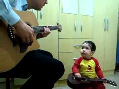 "Little boy singing ""Don't Let Me Down"" with  his father... He is so into it!"