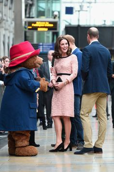 Paddington Bear greets Catherine Duchess of Cambridge and Prince William Duke of Cambridge at the Charities Forum Event on board the Belmond Britigh...