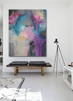 Abstract painting in modern interior. Pink, purple, grey, yellow by Rikke Laursen
