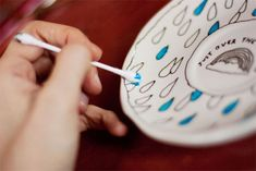 How to permanently paint dishes...wow! I need some porcelain markers and paint!  What to do with the plain white mugs and dishes from the dollar store!