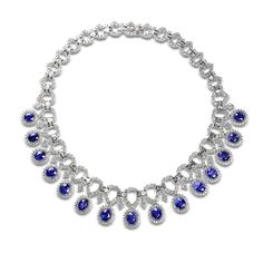 """Blue sapphire necklace accompanied by 39.91 carats of diamonds and 47.70 carats of blue sapphires. Set in 18 karat white gold. While priced on reserve, we are accepting offers below.  [gravityform id=""""1"""" title=""""false"""" description=""""false""""]"""