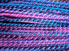 Blacklight  Handspun Falkland Wool Yarn by UnderThePlum on Etsy, $30.00. These are SO my colors!