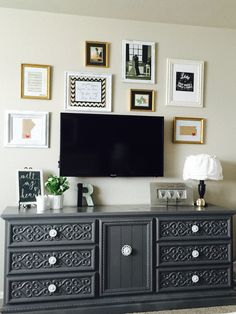 Thrift store frames, thrift store dresser, both spruced up with some spray paint! Decor on a budget!
