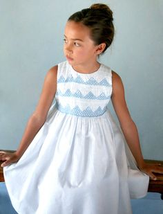 As sweet as can be, this classic hand smocked and hand embroidered soft confetti dot cotton girls dress is the picture of childhood.