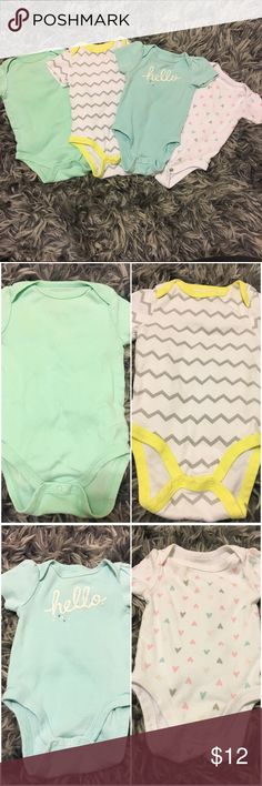 Set of 4 onesies Set of 4 Circo brand 0-3 month onesies. 1) mint green. 2) white/grey chevron with yellow trim 3) hello onesie on light teal 4) white with cute heart print all only worn once or twice with the exception of 3 which was probably worn 5 times. All in excellent condition Circo One Pieces
