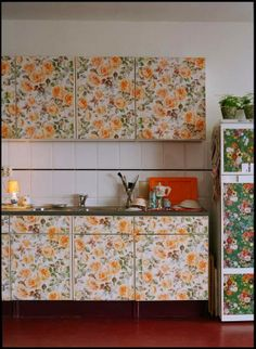 "creative  colorful way to makeover old fashioned ""modern"" (flat) kitchen cabinet doors with wallpaper."