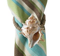 Another DIY option for beach theme napkin rings.......... just go down to the beach and collect some pretty shells and glue 'em on to a napkin ring!