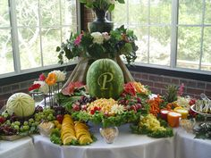 Fruit and cheese display.  Love the monogram watermelon. Peppers with dip in them.