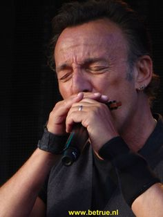 Bruce Springsteen playing the harmonica.