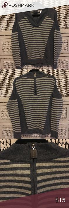 BCBG V neck sweater BCBG V neck sweater.  Partial zip up in the back at neck area. No stains.  Very tiny hole on a blue stripe near v neck area..it's not even noticeable to me, but it's there...so I'm telling you!  Super cute! BCBG Sweaters V-Necks