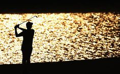 Sang-Moon Bae of South Korea hits his second shot on the 18th hole during the first round of The Players Championship in Florida