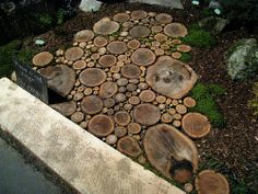 "I like this even better:  different sized rounds.  Make the rounds 3-6"" thick (pick a thickness) and soak in wood preservative before laying in gravel to extend the life of the walkway/patio."