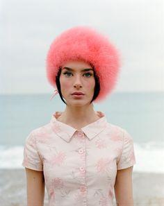 Faux fur hat and floral blouse.