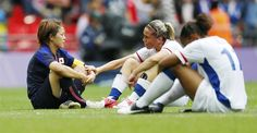 France's Camille Abilly is consoled by Japan's Aya Miyama, after Japan defeated France in the women's semi-final soccer match at Wembley Stadium in London at the London Olympic Games, on Aug. 6.