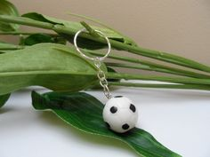 A personal favorite from my Etsy shop https://www.etsy.com/listing/249151198/soccer-ball-keychain-football-keychains