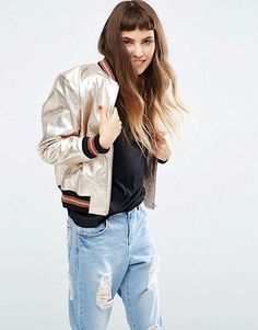 Bomber jackets are literally everywhere. Easily replacing last seasons favorites, this fun and sporty outerwear piece can be worn over feminine dresses to give it an edge or with an athleisure look to give off the ultimate cool-girl vibe. Check out 13 amazing bomber jackets to covet now.