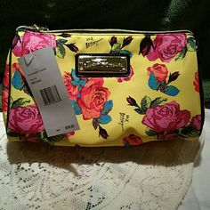 Betsey Johnson cosmetic bag BETSEY JOHNSON cosmetic bag. Yellow with vivid roses and xoxo Betsey.  Brand new, never used with tag. Betsey Johnson Bags Cosmetic Bags & Cases