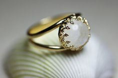 Round golden ring with moon stone Gold gemstone ring by nonnasoul, $47.00 Muy pretty