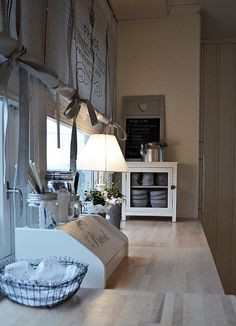 cute idea for shade with vertical blind behind also like the bows tied up.