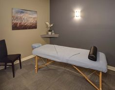 Massage Room Design a little too paired down, but like the corner wall shelf. Not over cluttered