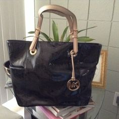 REDUCED Michae Kors Lg Jet Set Stunning Michael Kors Signature Monogram Mirror Black Metallic Tote.  Tan leather handles. Comes with original packaging. In EXCELLENT condition as is ALL of my MK handbags!! Michael Kors Bags