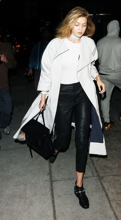 White tee + boots + duster coat. Moto-inspired boots alonf with a long trench and choker necklace add an extra element of cool to Gigi's simple leggings and white tee