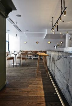 Joanna Laajisto has designed the interior of Michel restaurant, a renovation of an old hospitality institution in the heart of Helsinki's shopping district.