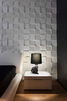 These handmade tiles are customised for this room, adding a sense of 'movement' to this feature wall.