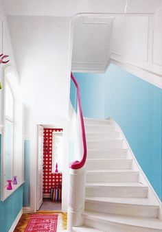 pink bannister. i'll bet this color is fun to slide down on top of.