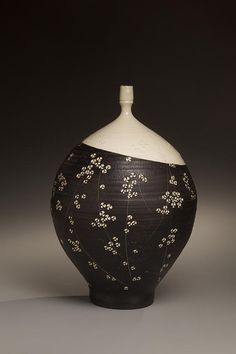 Textured black glazed stoneware vase with white glaze, impressed plum blossom patterning and white slip inlay (Inv# 6714), 1979 Kondõ Yutaka [1932-1983] Stoneware with slip glaze, 14 1/2 x 8 5/8 inches