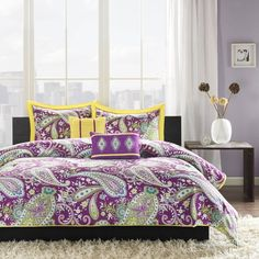 Kayla's large purple and white paisley print with green accents will surely enhance the character of your bedroom.
