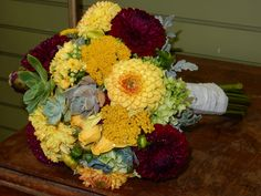 Lush autumn bridal bouquet featuring succulents, dahlias, hypericum berries and greenery, hand tied. Petal Town Flowers