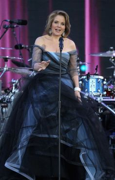 Does anybody know who designed Renee Fleming's Jubilee dress? I love it! x