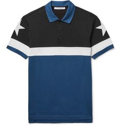 Even <a href='http://www.mrporter.com/mens/Designers/Givenchy'>Givenchy</a>'s most classic pieces have an effortless coolness about them. Made from panels of black, white and storm-blue cotton-piqué, this polo shirt is detailed with star appliqués at each shoulder - a recognisable brand motif chosen for its 'universal and positive symbolic value'.