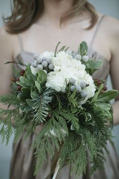 Fresh beautiful greens, a touch of silver gray and lovely white flowers - bet this bridal bouquet smells wonderful, used in the winter or really any time