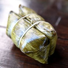 This traditional Thai dessert is made by wrapping sweet banana and sticky rice inside a banana leaf and steaming
